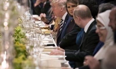 - putin e melania 400x240 - A foto que está a pressionar Donald Trump. Melania flirta com Putin